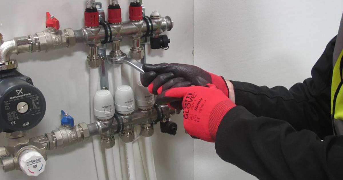 Contractor installing underfloor heating